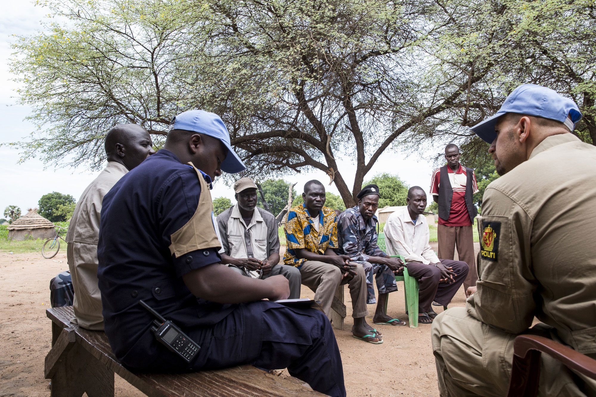 In South Sudan, UN Police with UNMISS visit local police authorities and meet with villagers to assess and report on the general situation in the area, criminal activity, detentions, and other matters that arise. UN Photo/JC McIlwaine