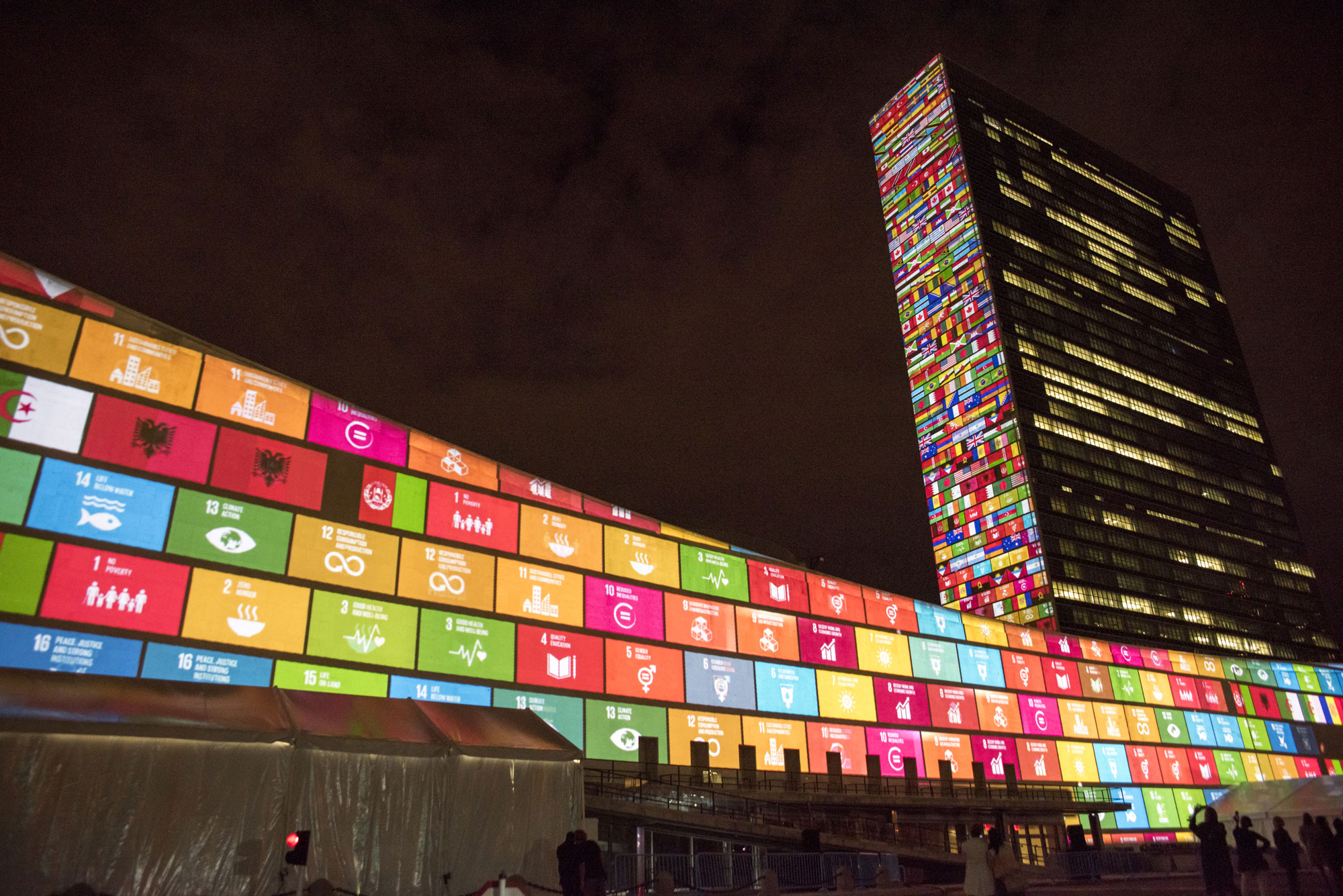 A film introducing the Sustainable Development Goals is projected on the UN's New York Headquarters buildings ahead of a General Assembly summit in September. UN Photo/Cia Pak