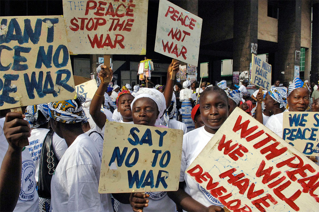 Participants march in Liberia's capital, Monrovia, in March 2007 to protest against gender-based violence. UN Photo/Eric Kanalstein