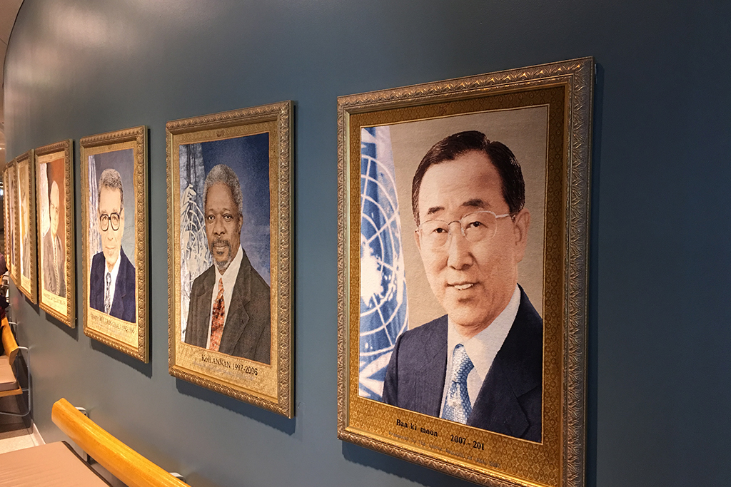 Portraits of the successive Secretaries-General hang on a wall outside the General Assembly Hall.  UN Photo/Masayoshi Suga