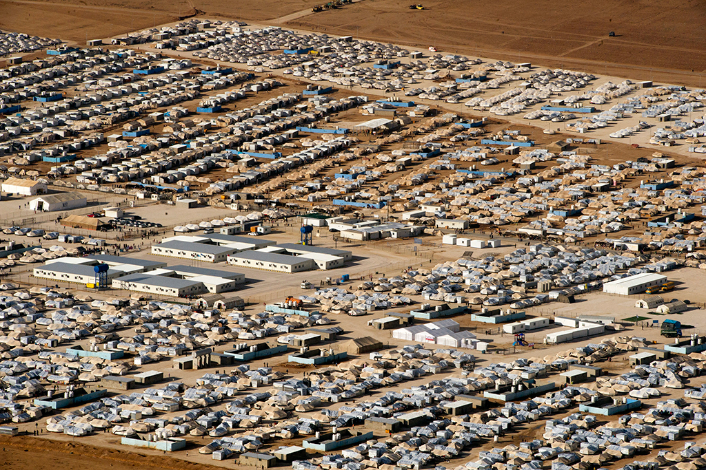 An aerial view of Za'atri refugee camp, host to tens of thousands of Syrians displaced by conflict, near Mafraq, Jordan. UN Photo/Mark Garten