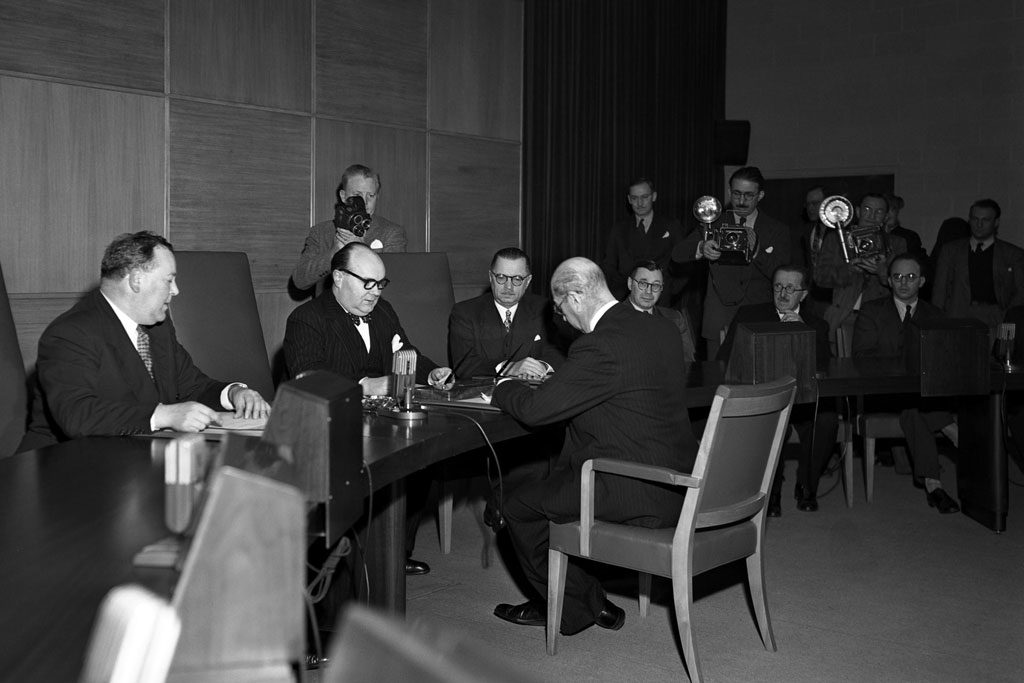 19 November 1946 – Afghanistan's linkages to the United Nations began in 1946, when the country became a member of the world body. Shown here, at the UN's temporary headquarters at Flushing Meadows in New York, the Afghan representative to the United States, A. Hosayn Aziz, signs – on behalf of his government – the 'instrument of adherence' to the UN Charter during the country's admission ceremony to membership in the United Nations. Those sitting in front of the ambassador include (from left) Secretary-General Trygve Lie and the President of the General Assembly at that time, Paul-Henri Spaak. UN Photo