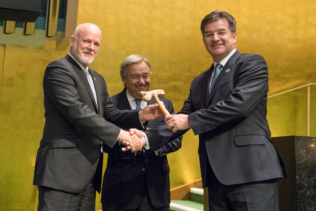Peter Thomson (left), President of the seventy-first session of the General Assembly, passes the gavel on to Miroslav Lajčák (right), President of the seventy-second session, as Secretary-General António Guterres looks on. UN Photo/Eskinder Debebe
