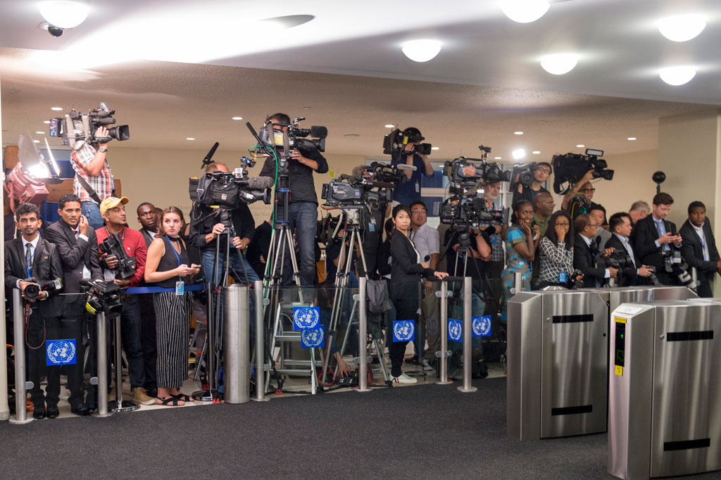 Thousands of journalists descended on UN Headquarters to cover the myriad events that take place in addition to the speeches delivered by world leaders, including this group awaiting the arrival of delegations to address the general debate. UN Photo/Rick Bajornas