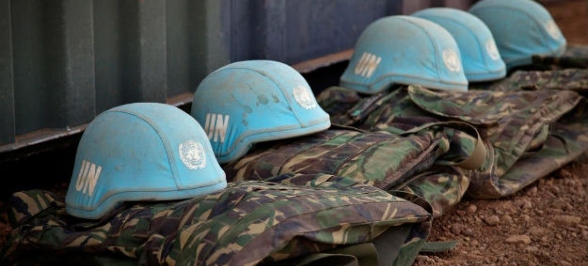 Blue helmets and uniforms of UN Peacekeepers.