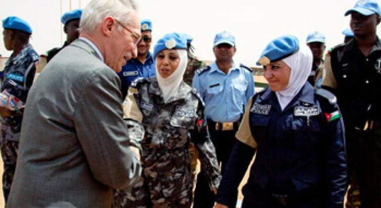 Edmond Mulet (left), Assistant Secretary-General for Peacekeeping Operations, greets Jordanian police advisers working with the African Union-UN Hybrid Operation in Darfur (UNAMID), during his visit to UNAMID's Mournei team site in West Darfur.