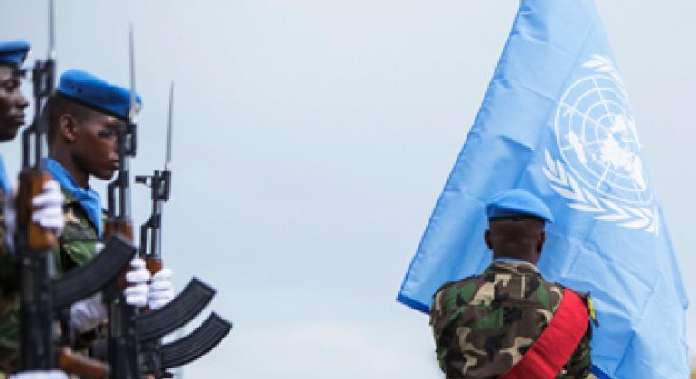 Peacekeepers of the UN Mission in the Republic of South Sudan (UNMISS) hoist the United Nations flag.