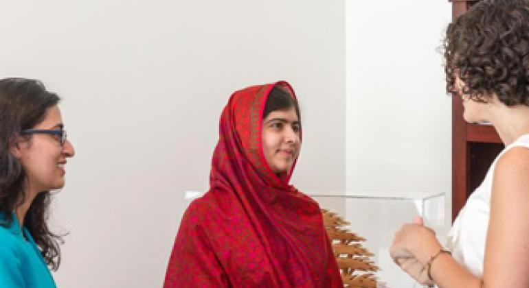 Malala Yousafzai (centre) with Olivia Curl (right) and Lena Shareef, creators of #GirlWithABook.