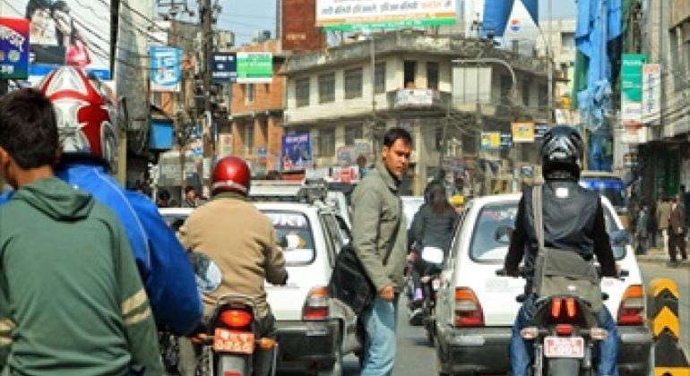 """On the first-ever World Cities Day, the UN highlighted the need for sustainable urban planning to make cities more """"liveable."""" Shown, street traffic in Kathmandu, Nepal. World Bank/Simone D. McCourtie"""