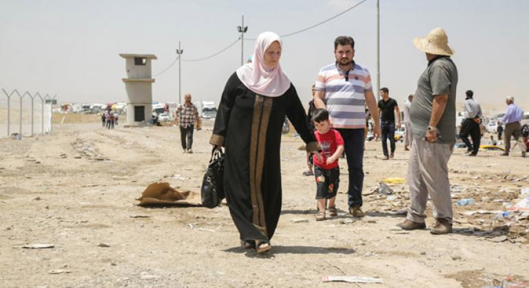 This family fled the fighting in Mosul, Iraq. File