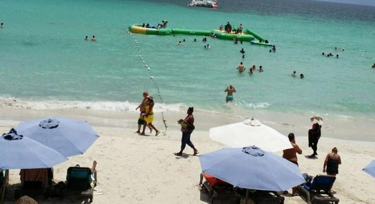 Tourists on the beach at Negril, a popular destination on the south coast of Jamaica.