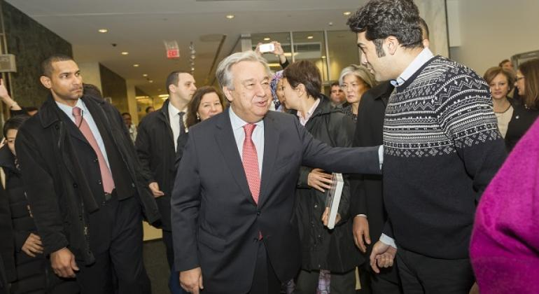 The new Secretary-General António Guterres greets assembled staff.
