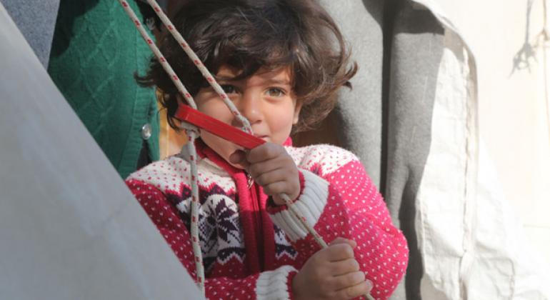 A little Syrian girl outside her family tent in Nizip 1 refugee camp, Gaziantep, southern Turkey.