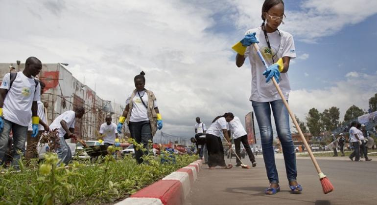 UN Volunteers and members of local organizations clear a busy road in Goma, eastern Democratic Republic of the Congo (DRC).