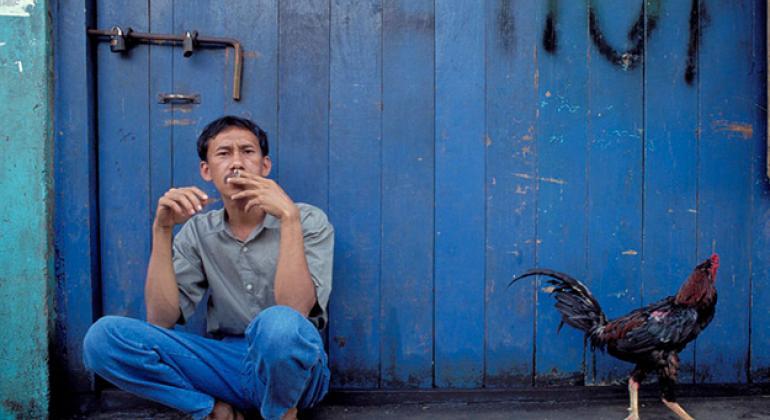 Man smoking in Indonesia.