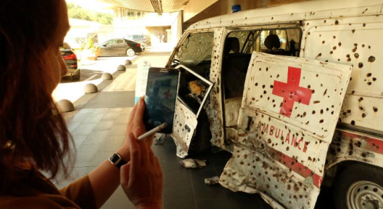 The destructive impact of high-velocity bullet fire on an ambulance, shown at the UN in Geneva.