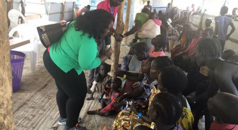 UN News' Jocelyne Sambira interviewing girls at the Imvepi refugee settlement in Arua district, northern Uganda. She travelled to Uganda with Secretary-General António Guterres, in June.