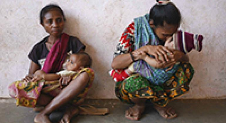 Mothers with their young children visit a mobile clinic in Asulau, Timor-Leste.