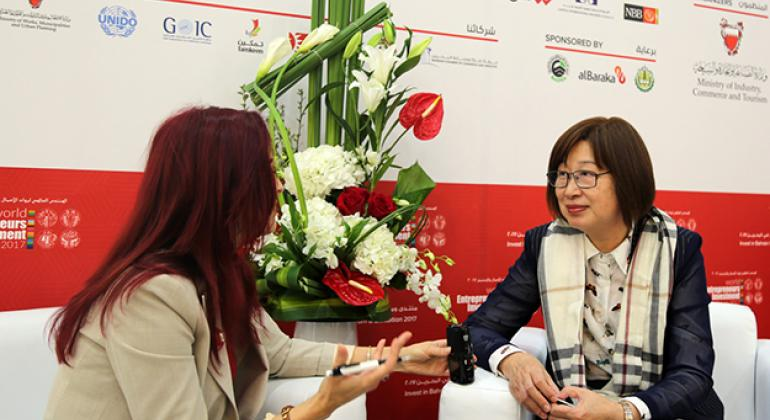 UN News's May Yaacoub speaking to Dan Liang,the Chairperson of Board of Directors, UN Maritime-Continental Silk Road Cities Alliance.