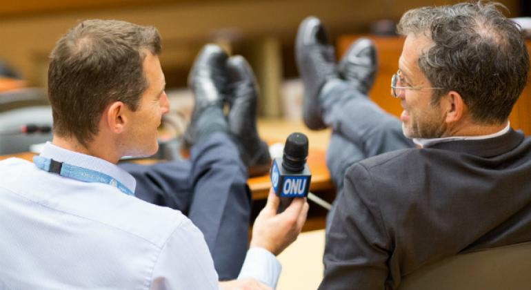 Kenneth Cole and Daniel Johnson discussing HIV/AIDS and shoes at the UN in Geneva.