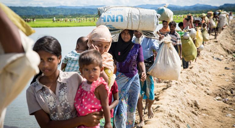 Rohingya families arrive at a UNHCR transit centre near the village of Anjuman Para, Cox's Bazar, Bangladesh after spending four days stranded at the Myanmar border with some 6,800 refugees.
