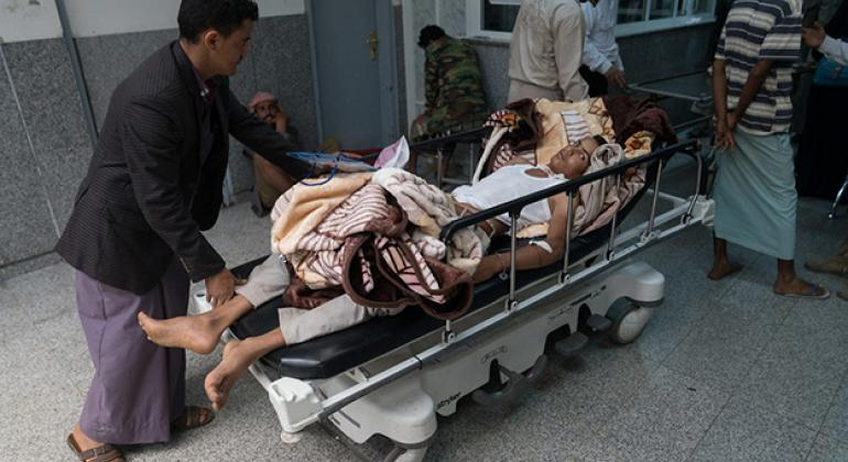 A suspected cholera patient is rushed into Al Joumhouri Hospital in Sana'a, Yemen.