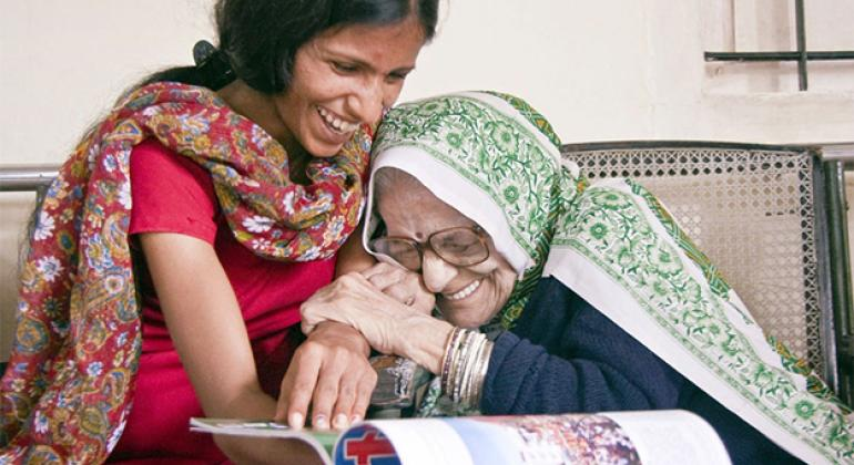 Ashwani, a caregiver at a centre in India, shares a laugh with Didi.