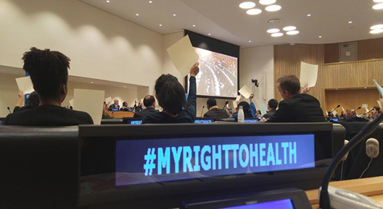"""During """"The Right to Health"""" event, in observance of World AIDS Day, participants engage in an AIDS knowledge-testing exercise. UN News/Elizabeth Scaffidi"""