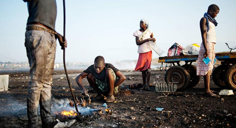 Workers at an e-waste dumpsite in Ghana. (file)