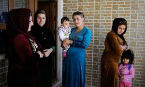 """Women chat together in the village of Halajay Gawra, northern Iraq, one of the villages UNICEF is working with to become """"FGM-free."""""""