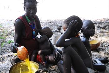 A woman and her children in South Sudan.