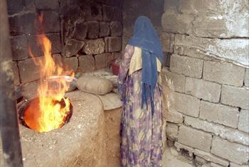 A woman baking bread in Iraq.