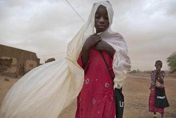 Children walk during a sand storm in Gao, Mali.