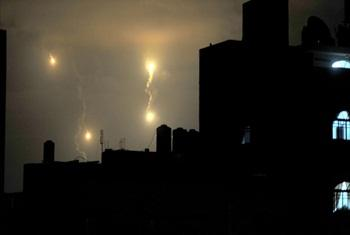 Israeli forces' flares light up the night sky of Gaza City on early Tuesday, July 29, 2014.