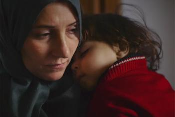 A Syrian mother and child. (UNHCR - video capture)