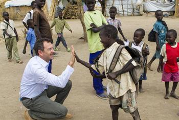Toby Lanzer, the Humanitarian Coordinator of the UN Mission in South Sudan (UNMISS), interacts with children at the refugee camp in Nyeel, South Sudan.