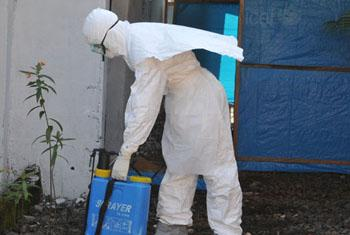 Health-care providers, still wearing their protective clothing, must thoroughly disinfect every place a person suspected to have Ebola passes through on the way to the health unit. WHO/Christina Banluta