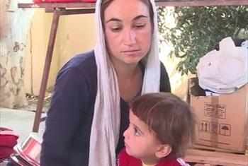 Chenar with her child. (UNHCR video capture)