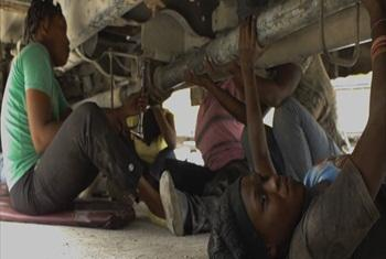 Girls fixing the bus. (UNifeed video capture)