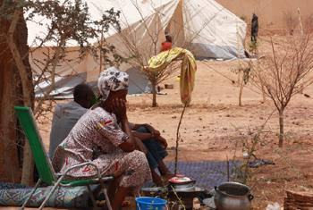 A displaced woman from northern Mali in the Sahel, waits at a temporary shelter near Mopti's main bus station.