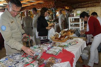 Austrian Peacekeeper checking sweets made by Mosan Center during a Christmas celebration organized in UNIFIL Headquarters in Naqoura South Lebanon. UNIFIL@PHOTO