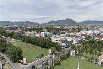 A bird's eye view of Banda Aceh as taken from the minaret of the city's Grand Mosque. 10 years after the devastating tsunami, the city has risen from the ruins.