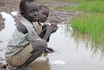 Children at Gendrassa refugee camp in Upper Nile State, South Sudan, play in a dirty puddle. Aid agencies say malnutrition in the camp has declined, but disease is still rife. © Hannah McNeish/IRIN