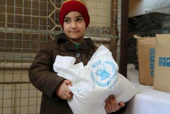 Syrian boy at a WFP distribution centre in Damascus. WFP-Dina_El-Kassaby