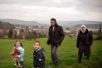 Young Abdu enjoys a walk with his family in the countryside near the German town Wächtersbach, where they were resettled. With cochlear implants and hearing aids, he can now hear almost perfectly.© UNHCR/G.Welters