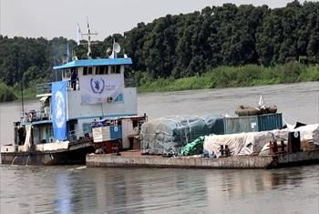 A WFP barge transporting food supplies on the Nile River.