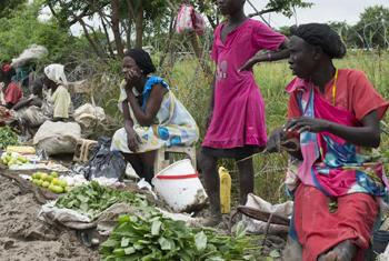 South Sudanese women sell produce along the road.