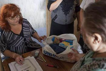 A woman collects aid items at a distribution centre in Nikolayevka, eastern Ukraine.