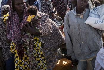 Kalthouma Abakar, 22, and her newborn daughter arrive in Baga Sola, Chad. UNHCR/Olivier Laban-Mattei