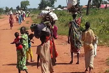Newly displaced civilians from Sudan's Nuba Mountains approach Yida in South Sudan.